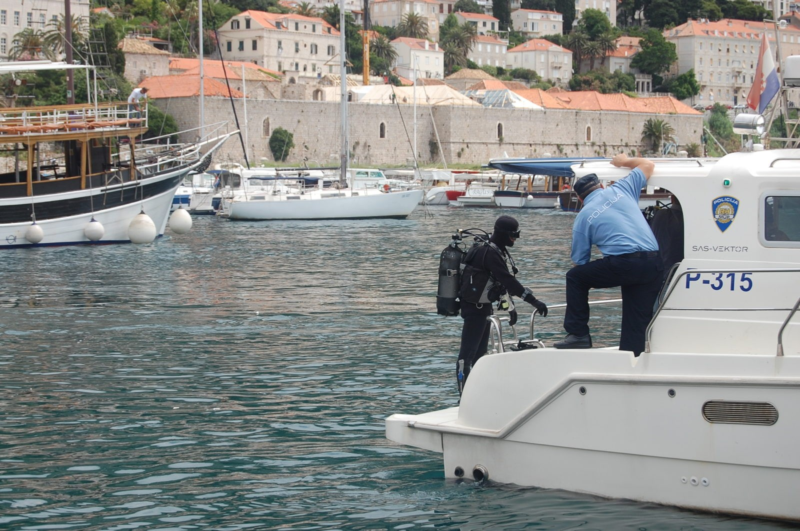 Photo of Divers Search For Missing Tourist Philipp Hochhuth In Old Harbour